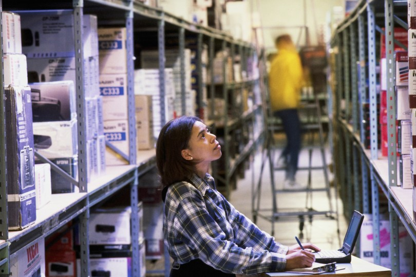 Employees Taking Inventory at an Electronics Warehouse